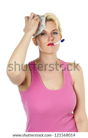 Portrait of a sick woman with ice pack and thermometer - stock photo