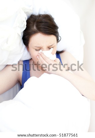 Portrait of a sick young woman relaxing in her bed