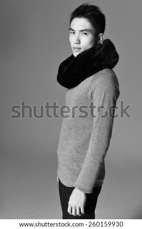 portrait of a side view young casual young man-black and white - stock photo