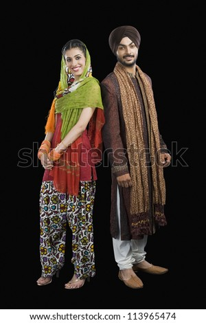 Portrait of a Sikh couple smiling - stock photo