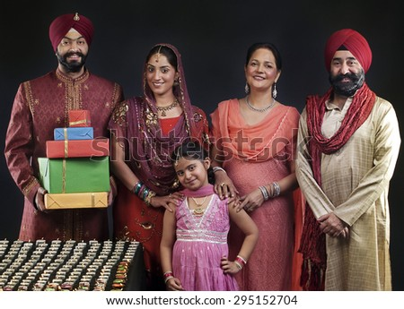 Portrait of a Sikh family with diyas - stock photo