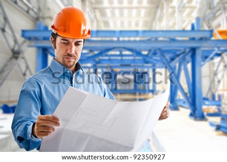 Portrait of a site manager reading a drawing