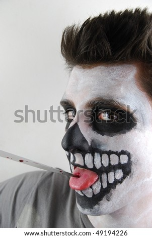 portrait of a skeleton guy as a murderer concept - stock photo