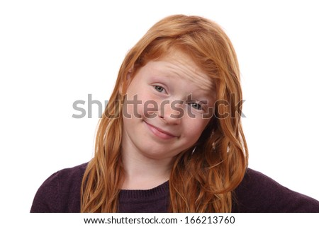 Portrait of a skeptical young girl on white background - stock photo