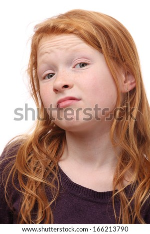 Portrait of a skeptical young girl on white background