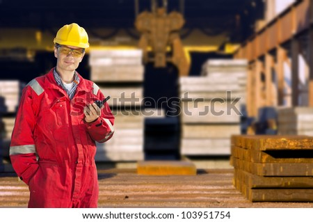 Portrait of a skinny operator in front of a steel mill - stock photo