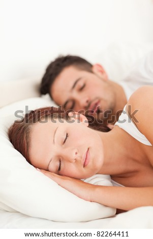 Portrait of a Sleeping couple in their bedroom