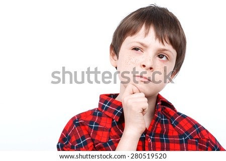 Portrait of a small boy thinking of something wearing checkered shirt close up isolated on white background - stock photo
