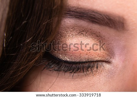 Portrait of a smart, beautiful brunette. Beauty portrait. Beautiful makeup.