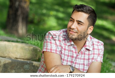 Portrait of a smile young man. Profile - sideways of happy gorgeous guy. - stock photo