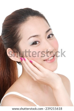 portrait of a smile young woman holding her face in hand
