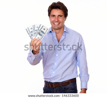 Portrait of a smiling adult man holding cash dollars on white background - stock photo