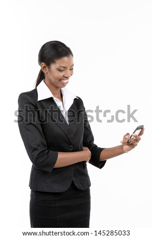 Portrait of a smiling African American businesswoman using smart phone.  Isolated on white