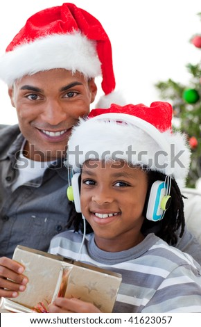 Portrait of a smiling Afro-American father and son at Christmas time - stock photo