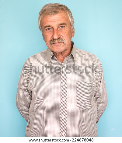 Portrait of a smiling and confident elderly good looking business man - stock photo