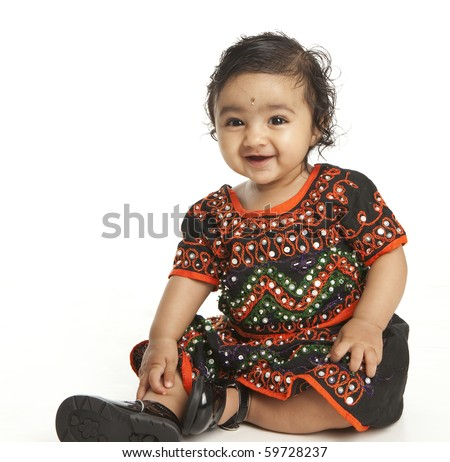 Portrait of a Smiling Asian Indian Baby Girl in Traditional Attire on White - stock photo