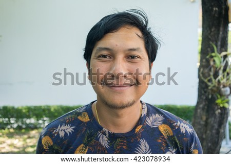 Portrait of a smiling Asian man , Thailand