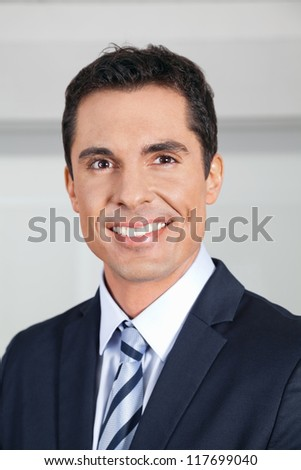 Portrait of a smiling attractive business manager - stock photo
