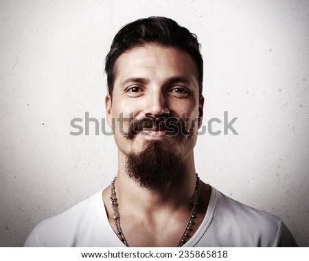 Portrait of a smiling bearded man - stock photo