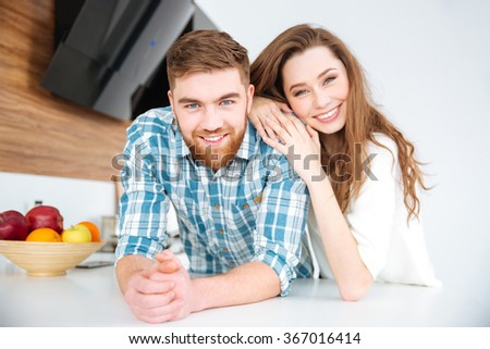 Portrait of a smiling beautiful couple looking at camera  - stock photo