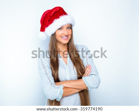 portrait of a smiling beautiful happy girl in christmas santa hat. beauty woman. isolated on white background. happy new year 2016.