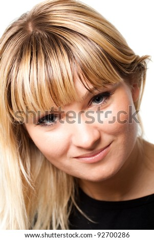 Portrait of a smiling blonde girl on a white background studio
