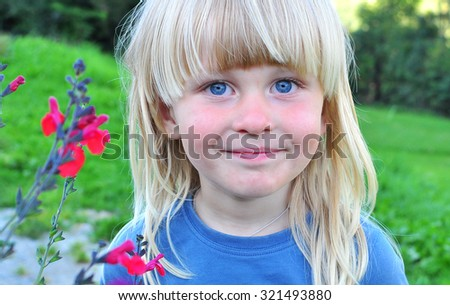 Portrait of a smiling boy with a blonde hair - stock photo