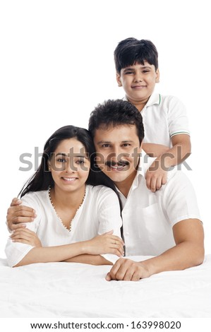 Portrait of a smiling boy with his parents - stock photo