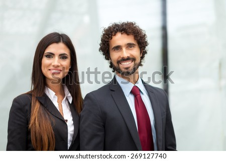 Portrait of a smiling business people couple - stock photo