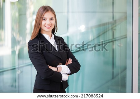 Portrait of a smiling business woman - stock photo