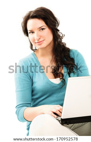 Portrait of a smiling business woman with a laptop - stock photo