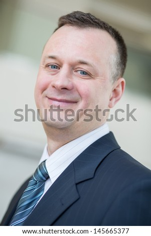 Portrait of a smiling businessman in a suit and tie