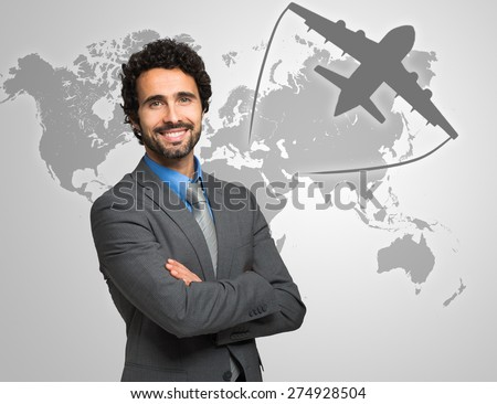 Portrait of a smiling businessman in front of a world map - stock photo