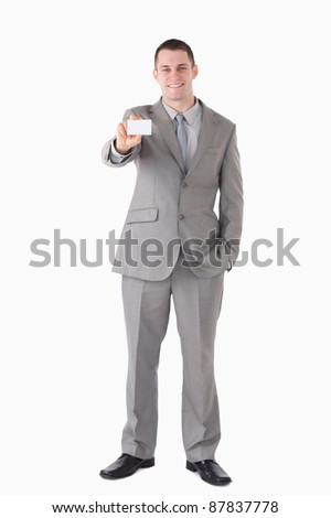 Portrait of a smiling businessman showing a business card against a white background - stock photo