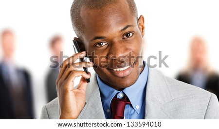 Portrait of a smiling businessman talking on the phone - stock photo
