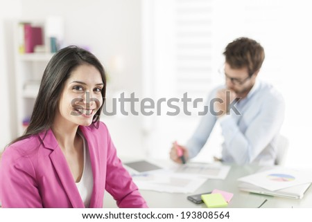 Portrait of a smiling businesswoman in meeting