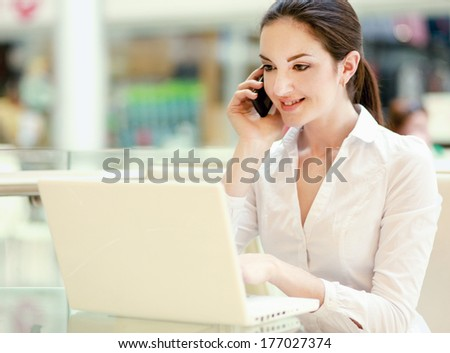 Portrait of a smiling businesswoman with phone