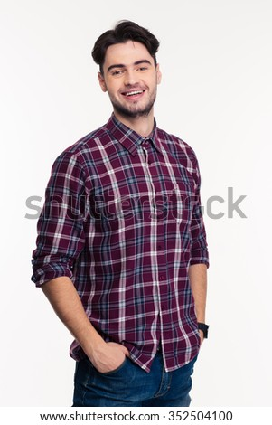 Portrait of a smiling casual man looking at camera isolated on a white background - stock photo