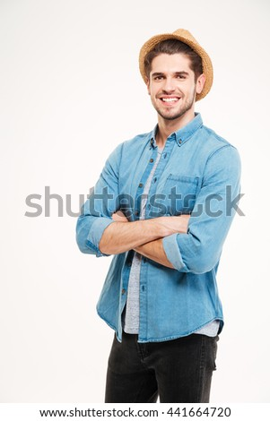 Portrait of a smiling casual man standing with hands crossed isolated on a white background