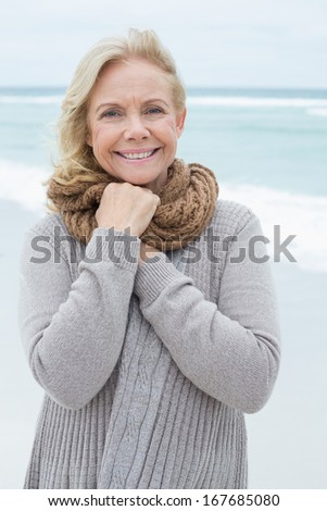 Portrait of a smiling casual senior woman relaxing at the beach