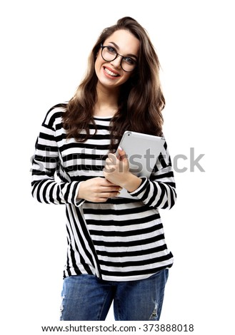 Portrait of a smiling casual woman holding tablet computer over white background - stock photo