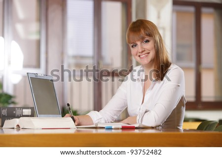 Portrait of a smiling caucasian teen girl studying at home - stock photo