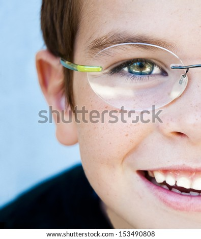Portrait of a smiling child wearing glasses