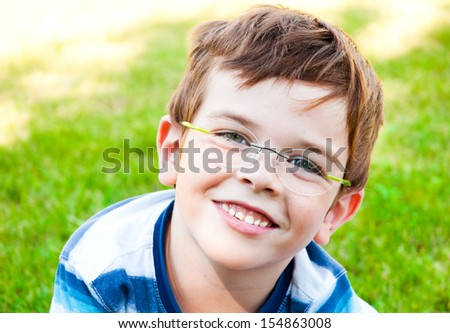 Portrait of a smiling child wearing glasses - stock photo