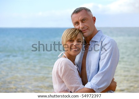 Portrait of a smiling couple at the beach