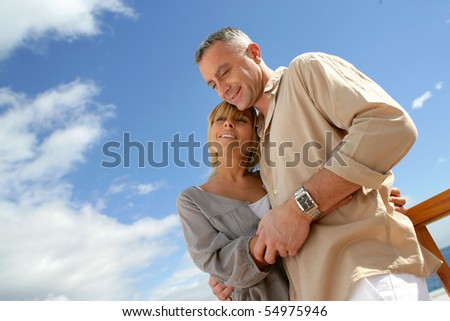 Portrait of a smiling couple embracing on a terrace
