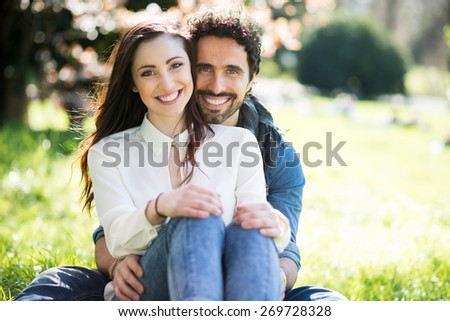 Portrait of a smiling couple having fun outdoors - stock photo