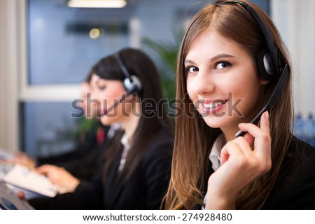 Portrait of a smiling customer representatives at work - stock photo