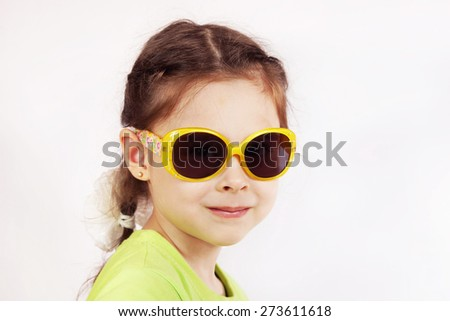 Portrait of a smiling cute little girl with sunglasses - stock photo