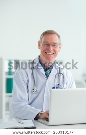 Portrait of a smiling doctor at his workplace